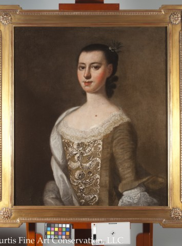 Jeremiah Theus, Portrait of Catherine DuTarque, c. 1774, oil on canvas.  All of the old losses were filled and retouched, allowing the painting to be seen as a complete portrait again.  The original frame was lost long ago and had been replaced by a 19th c. frame that was not appropriate to the period of the painting.  A new, reproduction frame was chosen to complement the picture.