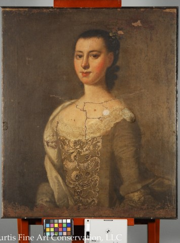 Jeremiah Theus, Portrait of Catherine DuTarque, c. 1774, oil on canvas. This portrait was coated with a synthetic resin varnish as well as a significant layer of yellowed wax resin from a lining during a previous restoration over 50 years ago.  At that time, the painting was stabilized and cleaned, but was not restored.